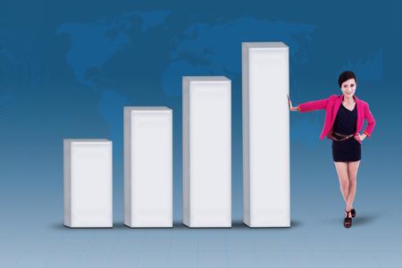 businesswoman standing: Businesswoman standing next to profit bar chart on blue background
