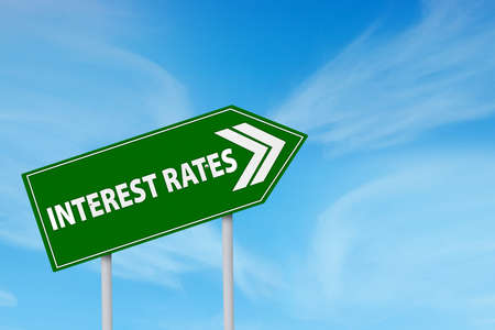 mortgage rates: Roadsign of higher interest rates ahead against blue sky