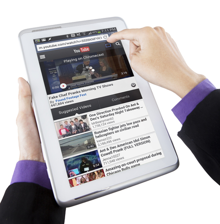 youtube: JAKARTA, SEPTEMBER 09, 2015: Image of businessman hands using tablet computer to open youtube online