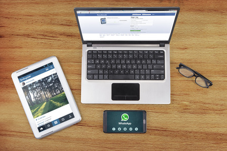 JAKARTA, SEPTEMBER 09, 2015: Three gadget of tablet, laptop, and smartphone showing three popular social media apps like facebook, whatsapp, and instagram