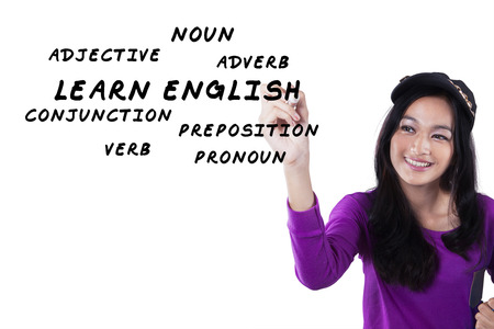 english girl: Image of a beautiful and smart teenage girl learns english and write the english materials on the whiteboard