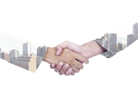 hand shake: Double exposure of two entrepreneurs shaking hands with a city background, isolated on white Stock Photo