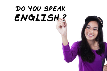 write a letter: Photo of female high school student write Do You Speak English?