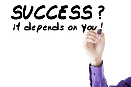 depends: Image of businessperson using black marker to write success it depends on you