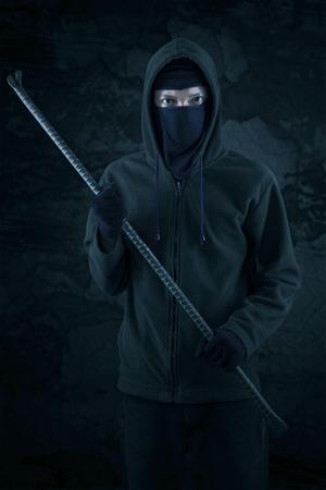 slink: Burglar with a crowbar is slink at night
