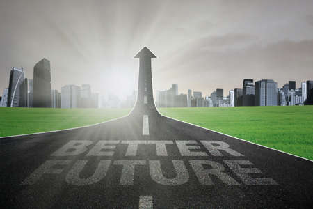 future city: Highway with Better Future text turning into arrow upward, symbolizing the road to increase better future