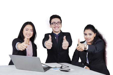 happy asian people: Portrait of multicultural business team celebrate their success and showing thumbs-up at the camera Stock Photo