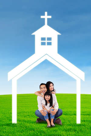 asian family: Asian family at field with church symbol