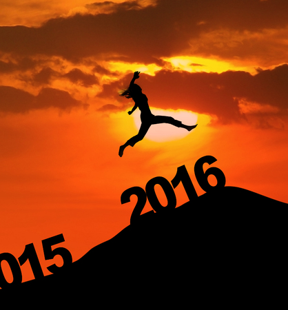 time of the year: Photo of silhouette woman leaps on the hill above numbers 2016 at dusk time. New year concept