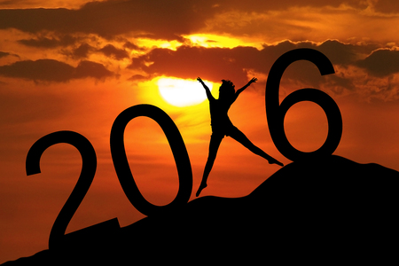 Image of silhouette happy woman jumping on the hill and forming numbers 2016