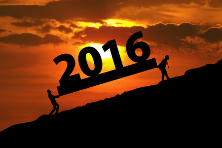 compile: Image of two silhouette male worker carrying numbers 2016 on the hill at sunset time