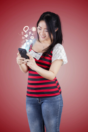 happy asian people: Photo of happy woman using mobile phone for internet browsing and access social media