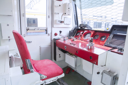 railway: Image of empty chair in the machinist room inside commuter trains Editorial