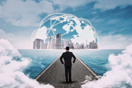 standing businessman: Businessman standing on the road and looking at the business global Stock Photo