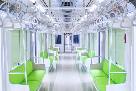 commuter train: Image of empty corridor train with empty seats and handrails, shot in the commuter train