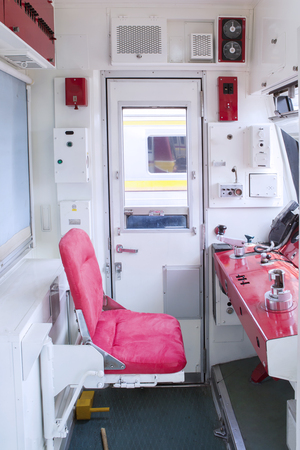 radio unit: Photo of control room with empty seat inside commuter train