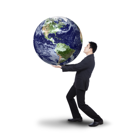 businessman carrying a globe: Successful businessman holding the earth planet, isolated on white background