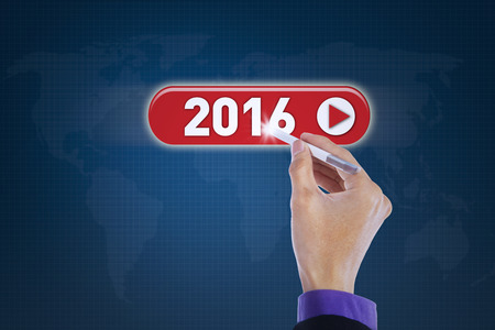 stylus pen: Image of businessperson hand using stylus pen to press numbers 2016 on the virtual screen
