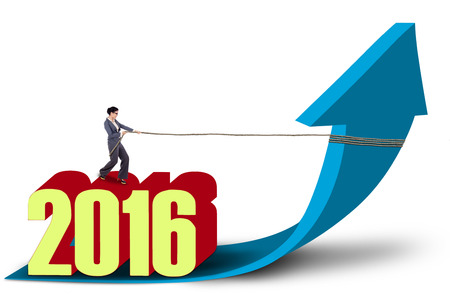 dragging: Young businesswoman dragging a blue arrow upward with a rope while standing on numbers 2016