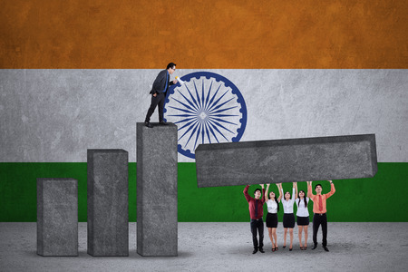 indian business man: Image of business team make financial chart together with Indian flag backdrop Stock Photo