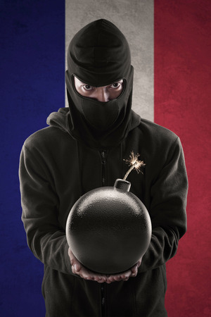 guerrilla: Terrorism concept: Terorrist holding a bomb in his hands. Background is French national flag