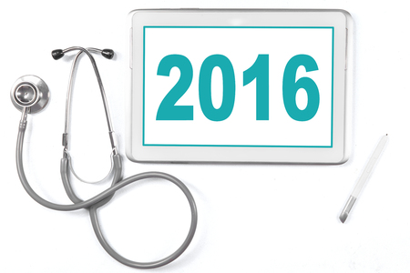 heal new year: Closeup of a digital tablet with number 2016 and stethoscope, isolated on white Stock Photo