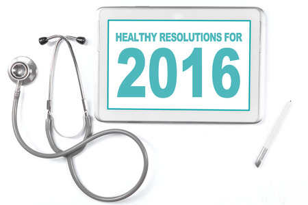 heal new year: Image of a digital tablet and stethoscope with a text of healthy resolution for 2016