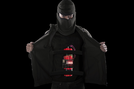 human time bomb: Terrorism concept: Terrorist wearing mask and showing a time bomb on his body for suicide attack Stock Photo