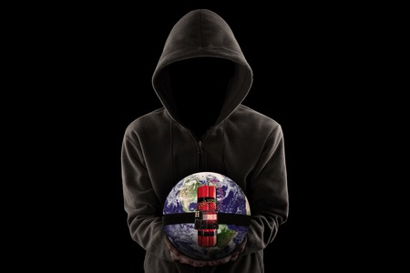 time bomb: Terrorism concept: Jihadist wearing hoodie and shows a time bomb with globe