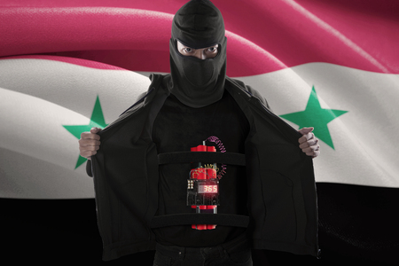 terrorism: Terrorism concept: Bomber suicide with a time bomb stick on his body with flag of Syria