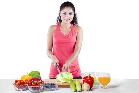 onion isolated: Beautiful young woman with sportswear, preparing superfood for diet program, isolated on white background