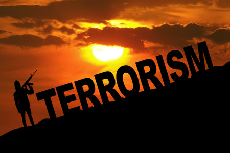 Silhouette of male terrorist holds a rifle with Terrorism text on the hill