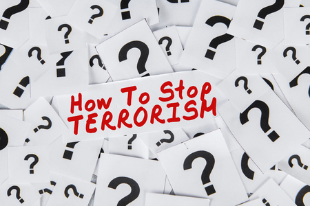 terrorism crisis: Closeup of question marks with a text of How To Stop Terrorism. Concept of question to stop terrorism