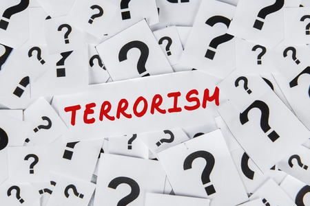terrorism crisis: Image of terrorism text on the paper and question mark. Concept of question about terrorism Stock Photo