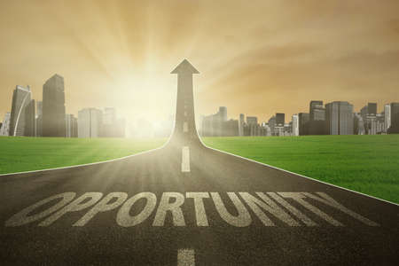 Road with Opportunity word turning into arrow upward, symbolizing the way to get and improve opportunity