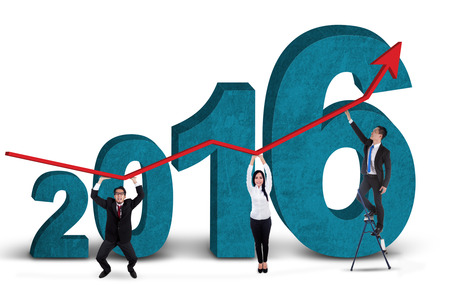 stockmarket: Three business people holding upward arrow together with numbers 2016, isolated on white background