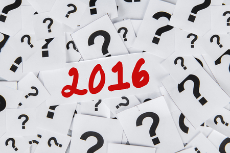 interrogative: Closeup of question mark symbol on the paper with numbers 2016