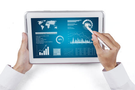 stylus pen: Man hand using stylus pen for touching the digital tablet with business chart on a screen