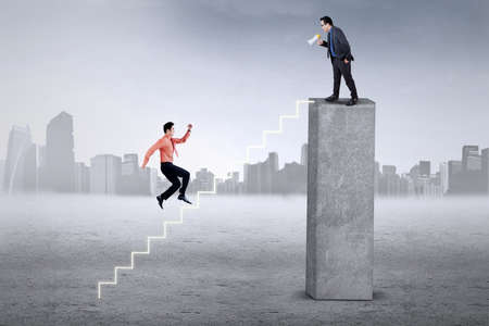 fussy: Male employee running hurry on the stair to meet with his boss on the top