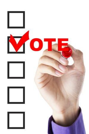 presidential election: Image of businessman hand fill a voting form on the whiteboard with a marker Stock Photo