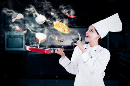 flavor: Indian female chef cooking in the kitchen with magic while wearing chef uniform