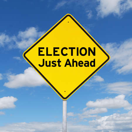 just ahead: Image of road sign with yellow color with a text of election just ahead. Election concept Stock Photo