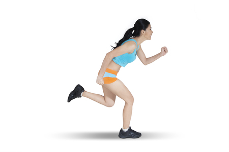 isolated woman: Female runner in sportswear jogging isolated on white background