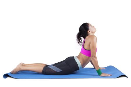 bhujangasana: Beautiful sporty woman practices yoga asana bhujangasana - cobra pose isolated on white background Stock Photo