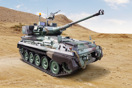 Image of a modern military tank with cannon on the field