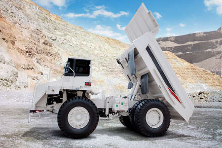 outside machines: Image of a big mining truck with white color on the mining site Stock Photo