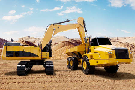 construction machinery: Image of yellow excavator loads soil on a truck with the shovel against blue sky