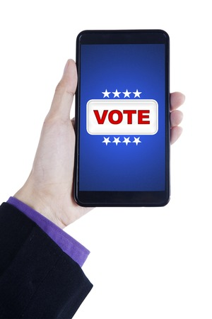 Closeup of businessperson hand holding smartphone with vote button on the screen, isolated on white background