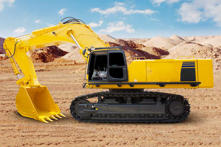 power shovel: New excavator with shovel on the construction site and ready to dig and tidy up the land Stock Photo