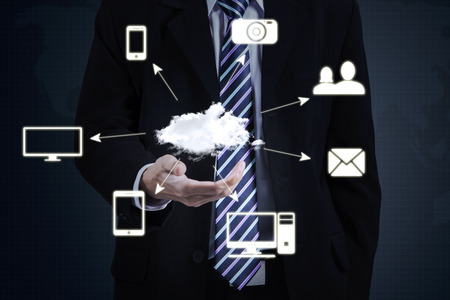 security man: Image of male entrepreneur in formal suit holding Cloud Computing diagram, technology connectivity concept